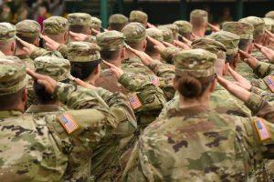 Service members saluting